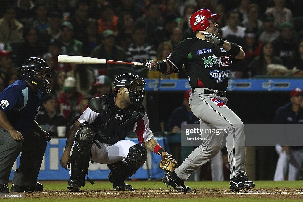 <a gi-track='captionPersonalityLinkClicked' href=/galleries/search?phrase=Karim+Garcia&family=editorial&specificpeople=214161 ng-click='$event.stopPropagation()'>Karim Garcia</a> of Mexico watches the flight of his home run during a match between Mexico and Puerto Rico for the Caribbean Series 2013 on February 6, 2013 in Hermosillo, Mexico.