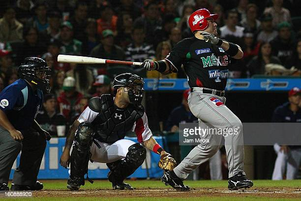 Karim Garcia of Mexico watches the flight of his home run during a match between Mexico and Puerto Rico for the Caribbean Series 2013 on February 6...