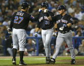 Karim Garcia of the New York Mets celebrates his tworun home run with teammates Todd Zeille and Mike Piazza against the Los Angeles Dodgers in the...