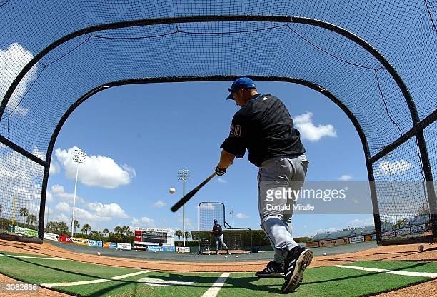 Karim Garcia of the New York Mets swings from the batting cage before his team's game against the Baltimore Orioles during Spring Training on March...