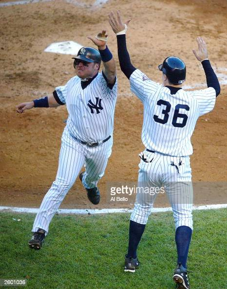 Karim Garcia of the New York Yankees celebrates with teammate Nick Johnson after scoring on a tworun double by Alfonso Soriano in the forth inning...
