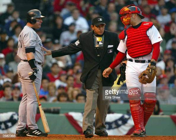 Karim Garcia of the New York Yankees reacts to being hit by a pitch by Pedro Martinez of the Boston Red Sox during Game 3 of the 2003 American League...