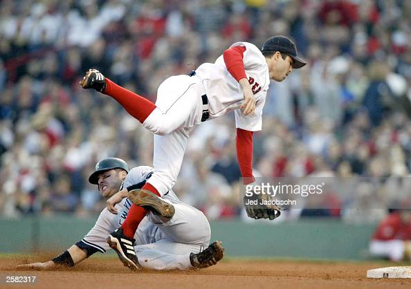 Karim Garcia of the New York Yankees slides into Todd Walker of the Boston Red Sox at second base during Game 3 of the 2003 American League...