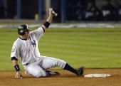 Karim Garcia of the New York Yankees slides safely into second base on a sacrifice bunt by teammate Aaron Boone in the fifth inning of game six of...