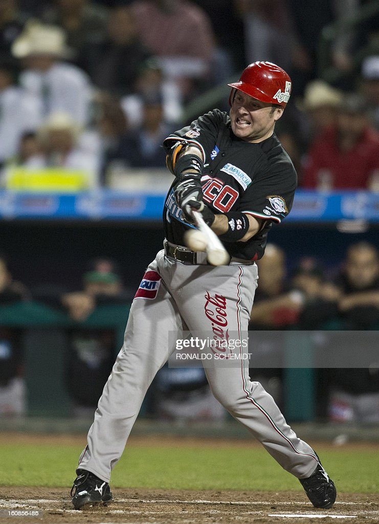Karim Garcia of Yaquis de Obregon of Mexico bats against Criollos de Caguas of Puerto Rico during the 2013 Caribbean baseball series on February 6, 2013 in Hermosillo in the northern Mexican state of Sonora. The Mexican team won 10-0. AFP PHOTO/Ronaldo Schemidt