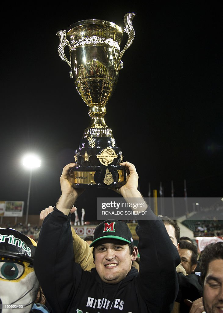 Karim Garcia of Yaquis de Obregon of Mexico celebrates with a trophy after the team's victory over Leones del Escogido of the Dominican Republic, during the final match of the 2013 Caribbean baseball series, on February 7, 2013, in Hermosillo, Sonora State, in northern of Mexico. Mexico won 4-3. AFP PHOTO/Ronaldo Schemidt