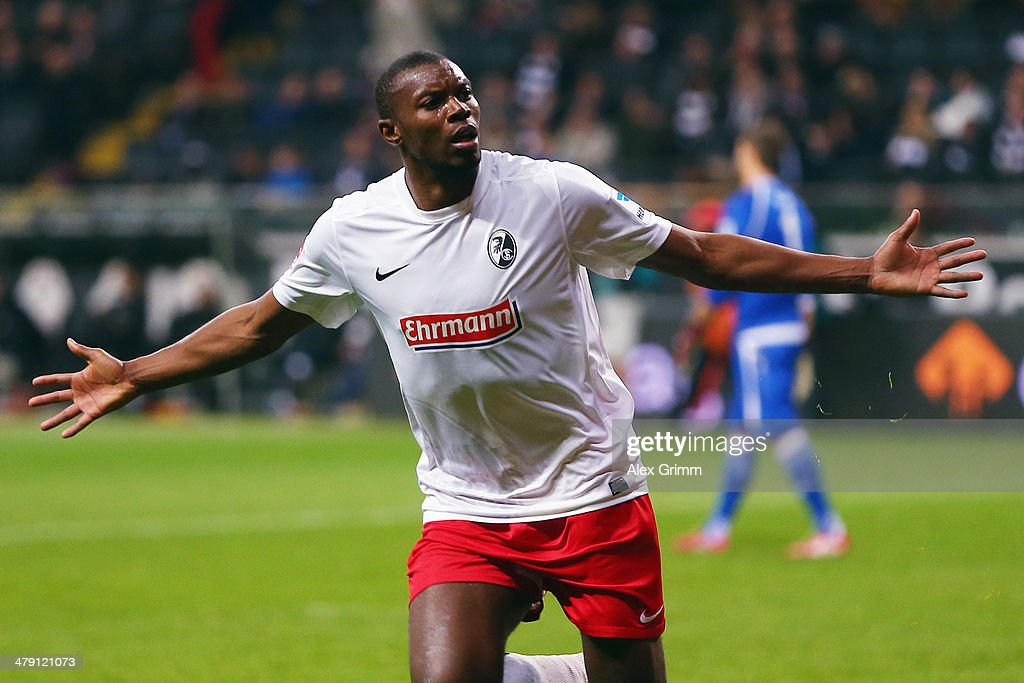 Karim Guede of Freiburg celebrates his team's fourth goal during the Bundesliga match between Eintracht Frankfurt and SC Freiburg at Commerzbank Arena on March 16, 2014 in Frankfurt am Main, Germany.