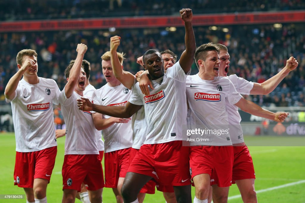 Karim Guede (C) of Freiburg celebrates his team's fourth goal with team mates during the Bundesliga match between Eintracht Frankfurt and SC Freiburg at Commerzbank Arena on March 16, 2014 in Frankfurt am Main, Germany.