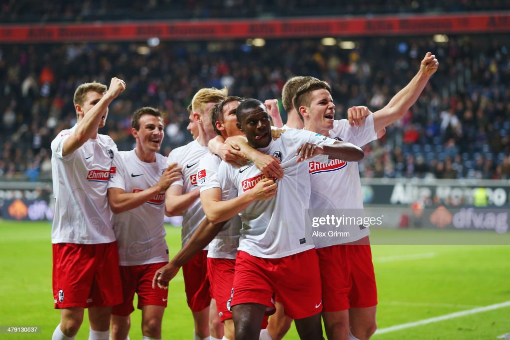 Karim Guede (front) of Freiburg celebrates his team's fourth goal with team mates during the Bundesliga match between Eintracht Frankfurt and SC Freiburg at Commerzbank Arena on March 16, 2014 in Frankfurt am Main, Germany.
