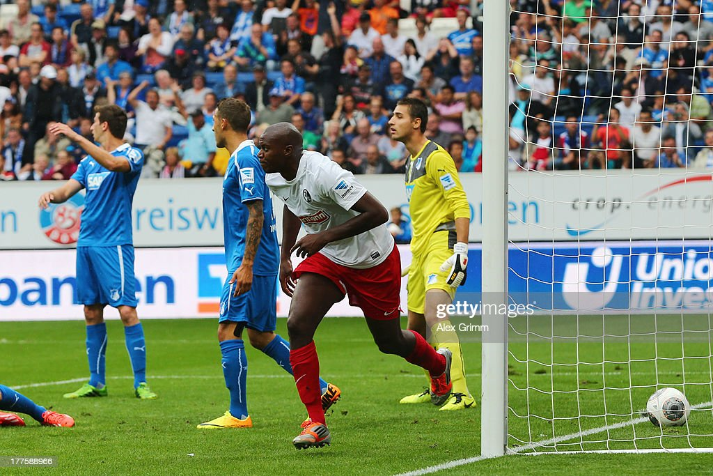 Karim Guede of Freiburg celebrates his team's second goal during the Bundesliga match between 1899 Hoffenheim and SC Freiburg at Wirsol Rhein-Neckar-Arena on August 24, 2013 in Sinsheim, Germany.