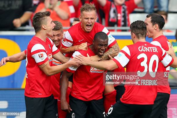 Karim Guede of Freiburg celebrates with his team mate Jonathan Schmid on his shoulders during the Bundesliga match between Sport Club Freiburg and FC...