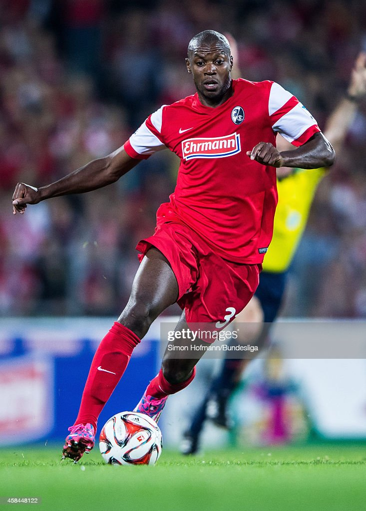 Karim Guede of Freiburg runs with the ball during the Bundesliga match between SC Freiburg and Hertha BSC Berlin at MAGE SOLAR Stadium on September 19, 2014 in Freiburg im Breisgau, Germany.