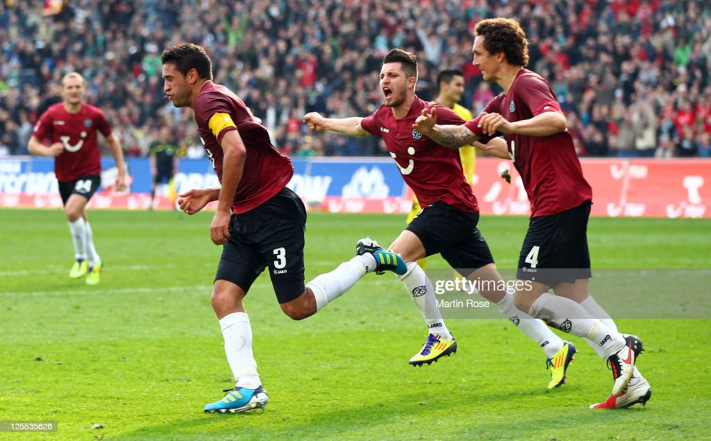 Karim Haggui of Hannover celebrates after he scores his team's equalizing goal during the Bundesliga match between Hannover 96 and Borussia Dortmund...