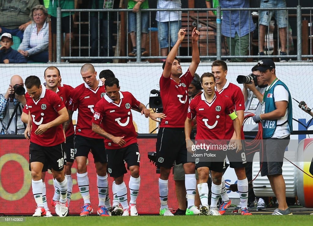 Karim Haggui (3rd R) of Hannover celebrates after scoring his team's first goal during the Bundesliga match between VfL Wolfsburg and Hannover 96 at Volkswagen Arena on September 2, 2012 in Wolfsburg, Germany.