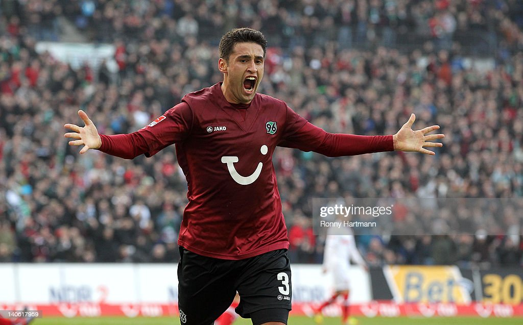 Karim Haggui of Hannover celebrates his teams first goal during the Bundesliga match between Hannover 96 and FC Augsburg at AWD Arena on March 03, 2012 in Hanover, Germany.