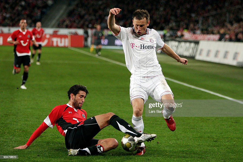 Karim Haggui of Hannover challenges Ivica Olic of Muenchen during the Bundesliga match between Hannover 96 and FC Bayern Muenchen at AWDArena on...