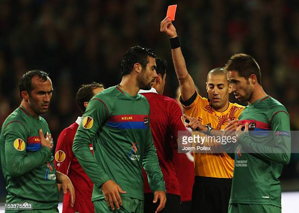 Karim Haggui of Hannover gets the red card from referee Liran Liany during the UEFA Europa League Group L match between Hannover 96 and Levante UD at...
