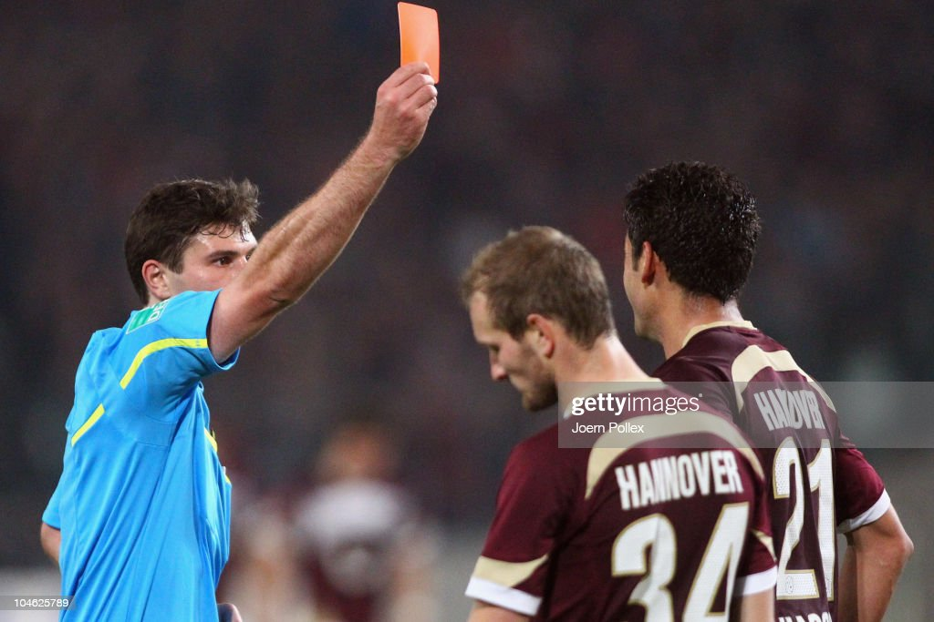 Karim Haggui of Hannover gets the red card from refferee Markus Wingenbach during the Bundesliga match between Hannover 96 and FC St Pauli at AWD...