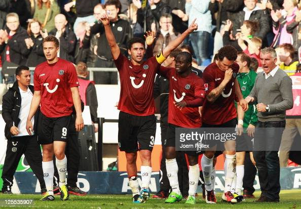 Karim Haggui of Hanover celebrates after scoring his team's first goal during the Bundesliga match between Hanover 96 and Borussia Dortmund at AWD...