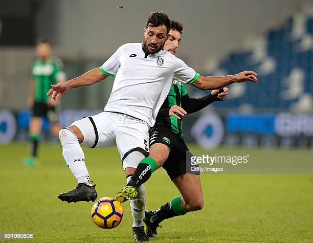 Karim Laribi of AC Cesena competes for the ball with Lorenzo Pellegrini of US Sassuolo Calcio during the TIM Cup match between US Sassuolo and AC...