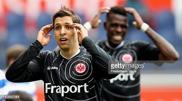 Karim Matmour and Mohamadou Idrissou of Frankfurt react during the Second Bundesliga match between MSV Duisburg and Eintracht Frankfurt at...