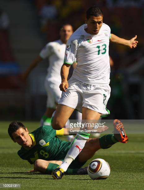 Karim Matmour of Algeria evades a challenge by Robert Koren of Slovenia during the 2010 FIFA World Cup South Africa Group C match between Algeria and...