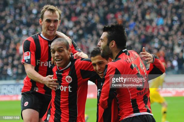Karim Matmour of Frankfurt celebrates with team mates after scoring his team's fourth goal during the Second Bundesliga match between Eintracht...
