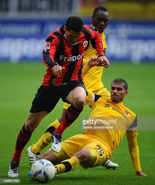 Karim Matmour of Frankfurt is challenged by Aimen Demai of Aachen during the Second Bundesliga match between Eintracht Frankfurt and Alemannia Aachen...