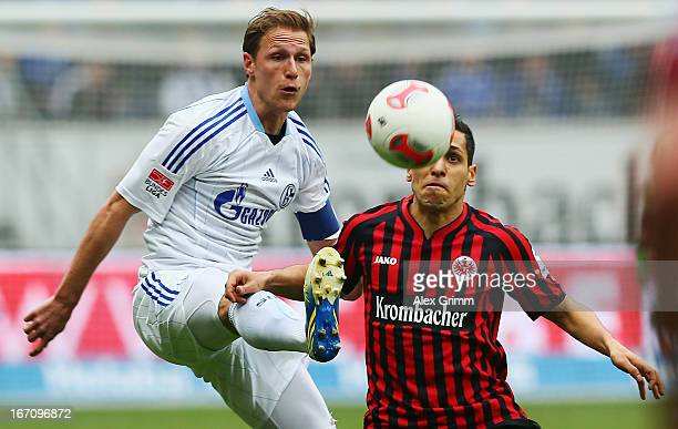 Karim Matmour of Frankfurt is challenged by Benedikt Hoewedes of Schalke during the Bundesliga match between Eintracht Frankfurt and FC Schalke 04 at...