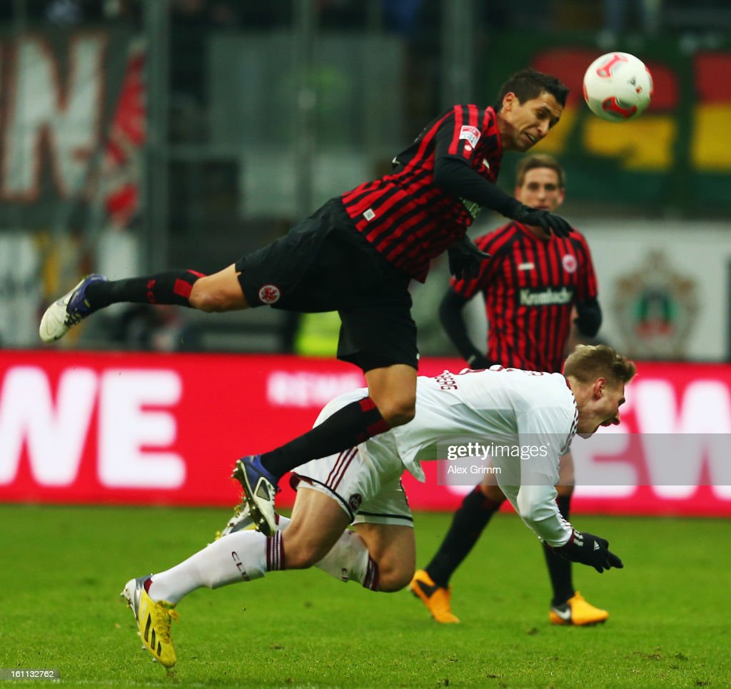 <a gi-track='captionPersonalityLinkClicked' href=/galleries/search?phrase=Karim+Matmour&family=editorial&specificpeople=741965 ng-click='$event.stopPropagation()'>Karim Matmour</a> (top) of Frankfurt is challenged by Sebastian Polter of Nuernberg during the Bundesliga match between Eintracht Frankfurt and 1. FC Nuernberg at Commerzbank-Arena on February 9, 2013 in Frankfurt am Main, Germany.