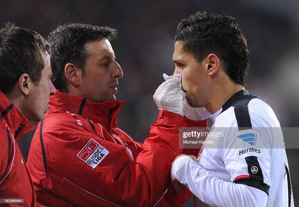 <a gi-track='captionPersonalityLinkClicked' href=/galleries/search?phrase=Karim+Matmour&family=editorial&specificpeople=741965 ng-click='$event.stopPropagation()'>Karim Matmour</a> of Frankfurt receives treatment during the Bundesliga match between SC Freiburg and Eintracht Frankfurt at MAGE SOLAR Stadium on February 22, 2013 in Freiburg, Germany.