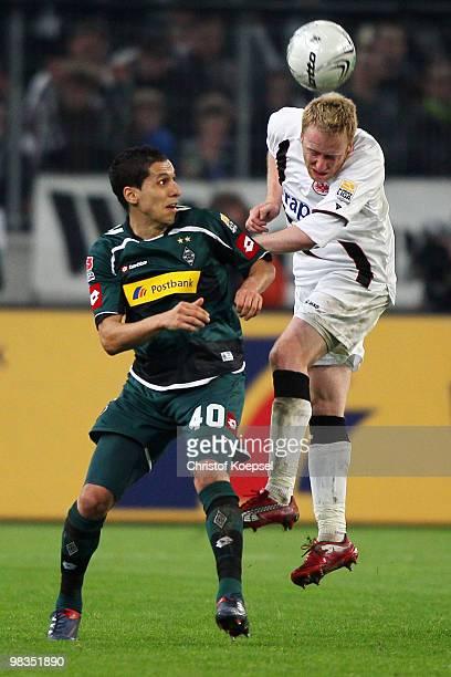 Karim Matmour of Gladbach and Patrick Ochs of Frankfurt jump for a header during the Bundesliga match between Borussia Moenchengladbach and Eintracht...