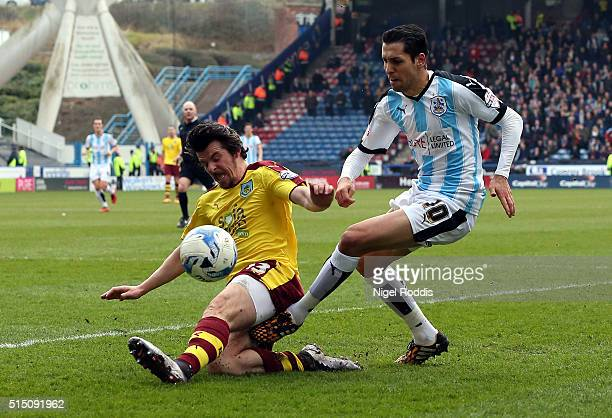 Karim Matmour of Huddersfield Town is challenged by Joey Barton of Burnley during the Sky Bet Championship match between Huddersfield Town and...
