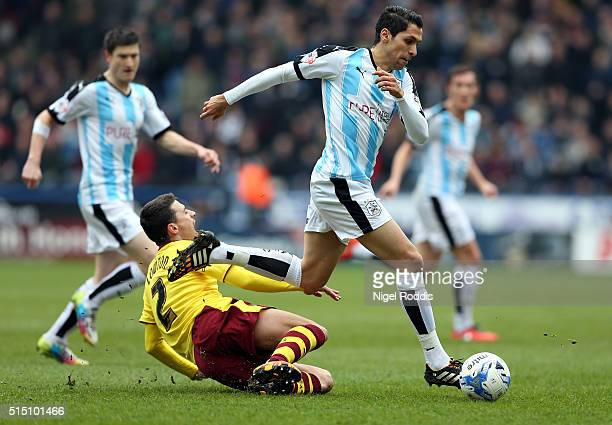 Karim Matmour of Huddersfield Town is challenged by Matt Lowton of Burnley during the Sky Bet Championship match between Huddersfield Town and...