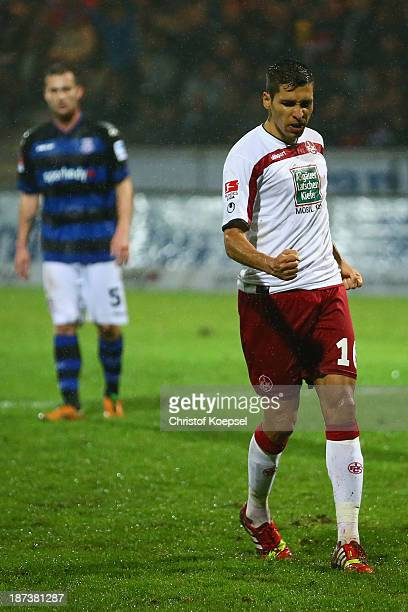 Karim Matmour of Kaiserslautern celebrates the third goal after socring a penalty during the Second Bundesliga match between FSV Frankfurt and 1 FC...