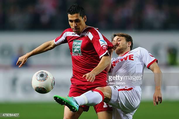 Karim Matmour of Kaiserslautern is challenged by Daniel Halfar of Koeln during the Second Bundesliga match between 1 FC Kaiserslautern and 1 FC Koeln...