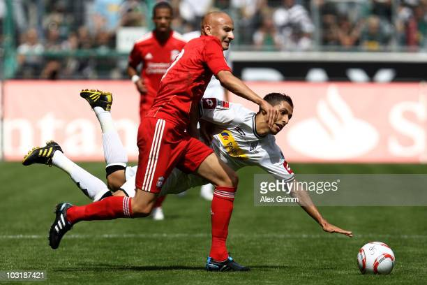 Karim Matmour of M'Gladbach is challenged by Jonjo Shelvey of Liverpool during the preseason friendly match between Borussia M'Gladbach and Liverpool...