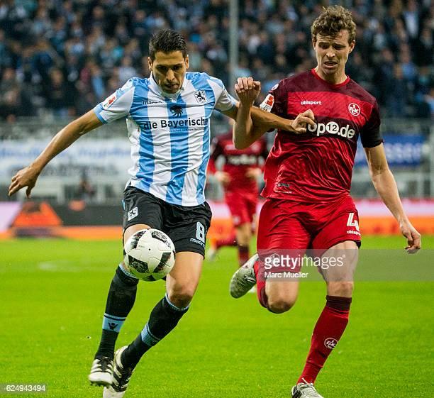 Karim Matmour of TSV 1860 Muenchen is challenged by Patrick Ziegler of 1 FC Kaiserslautern during the Second Bundesliga match between TSV 1860...