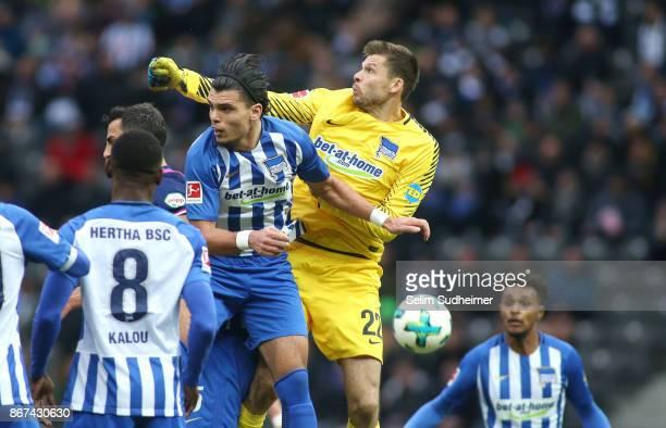 Karim Rekik and Goalkeeper Rune Jarstein of Hertha BSC fight for the ball with during the Bundesliga match between Hertha BSC and Hamburger SV at...