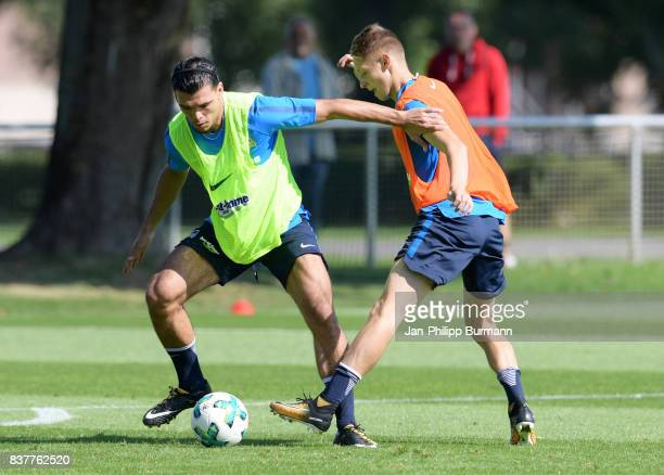 Karim Rekik and Palko Dardai of Hertha BSC fight for the ball during the training on august 23 2017 in Berlin Germany