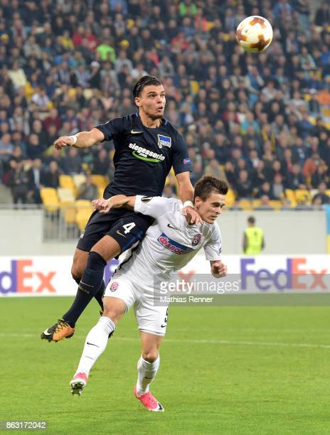 Karim Rekik of Hertha BSC and Artem Gordienko of FC Zorya Luhansk during the Europa League group J game between Zorya Luhansk against Hertha BSC on...