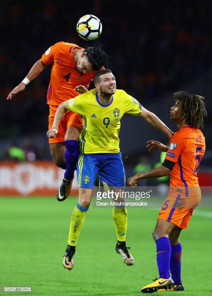 Karim Rekik of Netherlands and Marcus Berg of Sweden compete for the ball as Nathan Ake of Netherlands looks on during the FIFA 2018 World Cup...