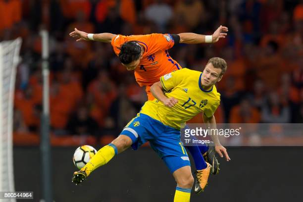 Karim Rekik of Netherlands and Viktor Claesson of Sweden battle for the ball during the FIFA 2018 World Cup Qualifier between Netherlands and Sweden...