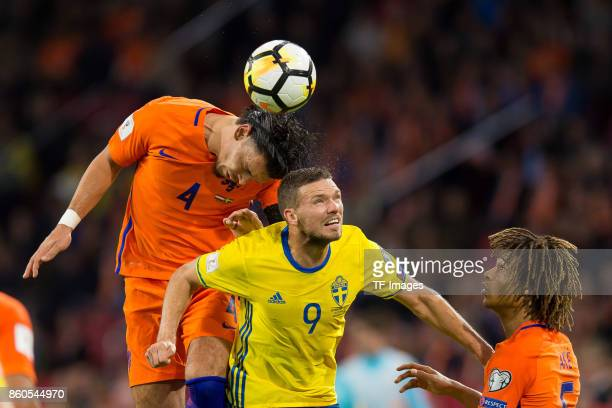 Karim Rekik of Netherlands Marcus Berg of Sweden and Nathan Ake of Netherlands battle for the ball during the FIFA 2018 World Cup Qualifier between...