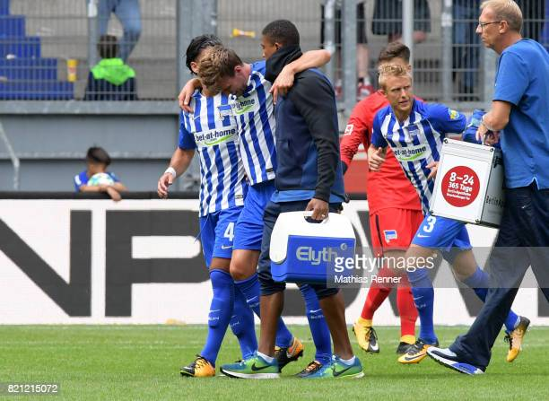 Karim Rekik Sebastian Langkamp and physiotherapist Frederick Syna of Hertha BSC during the game between Aston Villa and Hertha BSC on july 23 2017 in...