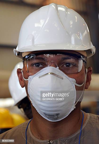 Karim Wade consultant and son of Sengal's President Abdoulaye Wade listens to a technician on April 30 2008 during a visit to a phosphate mine in...