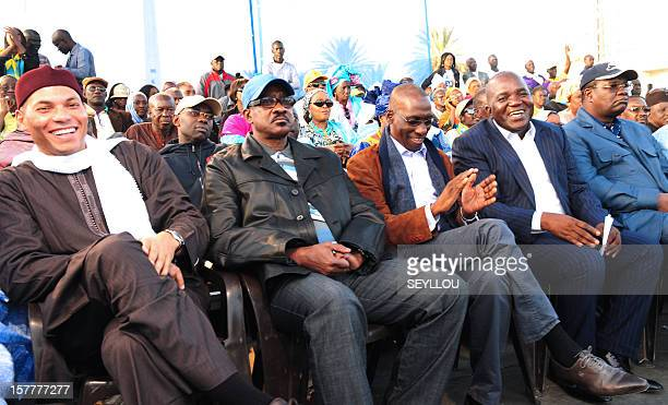 Karim Wade son of former Senegalese president Abdoulaye Wade sit along with members of the Senegalese Democratic Party Oumar Sarre Mamadou Diop...