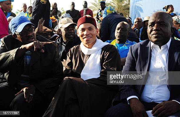 Karim Wade son of former Senegalese president Abdoulaye Wade sit along with members of the Senegalese Democratic Party Oumar Sarre and Madicke Niang...