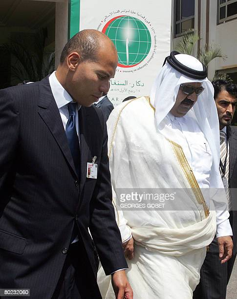 Karim Wade son of Senegalese President Abdoulaye Wade walks with the Emir of Qatar Sheikh Hamad bin Khalifa AlThanile during the 11th session of the...