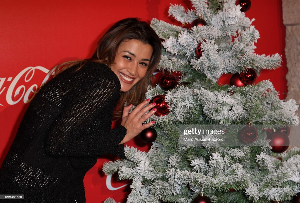 Karima Charni poses at the Coca Cola Christmas windows inauguration at Le Showcase on November 26, 2012 in Paris, France.